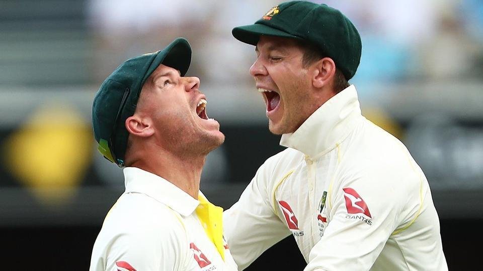 Tim Paine and Warner dance to collect the ball