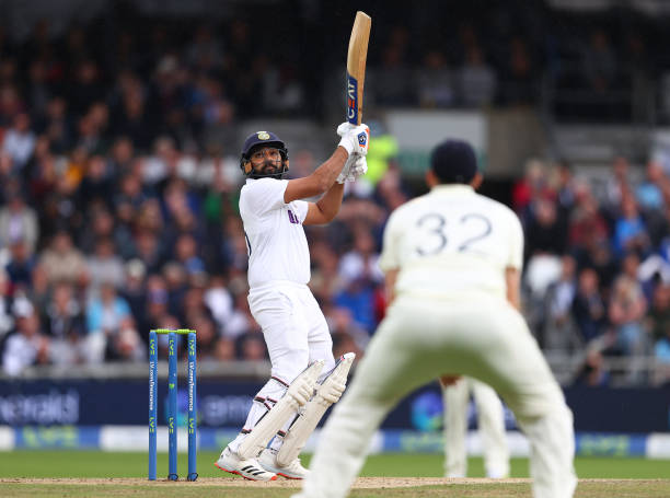 Rohit Sharma goes for a marvellous six off Ollie Robinson's Ball